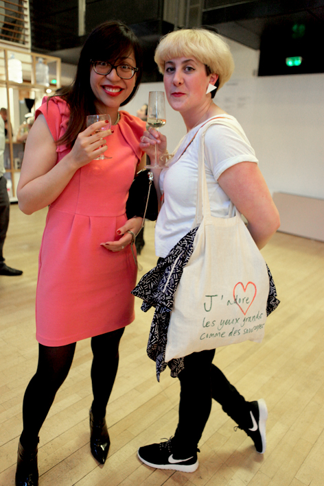"Anémone and Jocie had traveled from Dijon and London to be at the opening. Jocie's very special bag is certainly a one-of-a-kind with this fabulous inscription: ""J'adore les yeux grands comme des soucoupes."" Oh the love!"